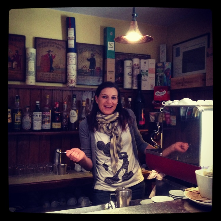 SILVIA WELCOMING ME BY THE COFFEE MACHINE