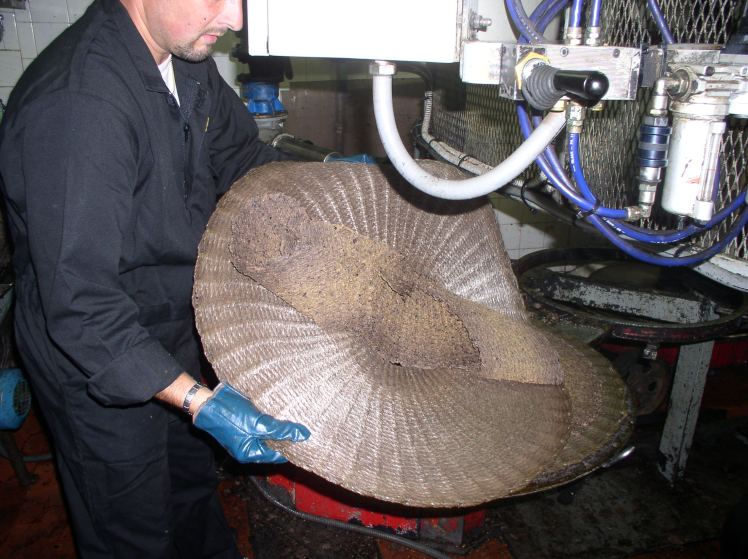 THE OLIVE PASTE IS READY TO BE PRESSED