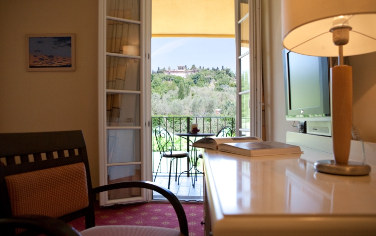 Another room with a balcony overlooking the olive trees