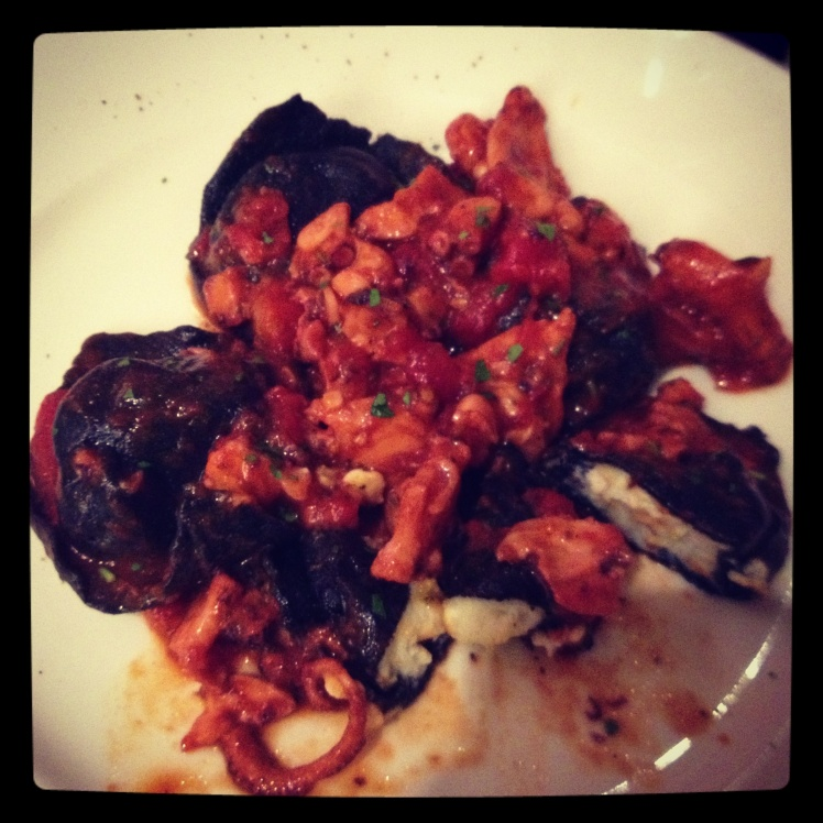 Black ravioli with octopus red hot sauce
