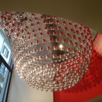 Illy Caffè in Rome : a shining  chandelier made of silver cups